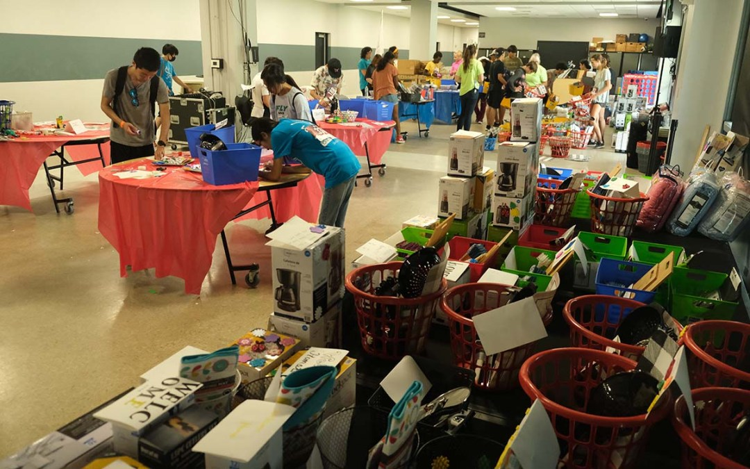 Teens prepare baskets for Just In Time, an organization helping foster children. Photo by Chris Stone