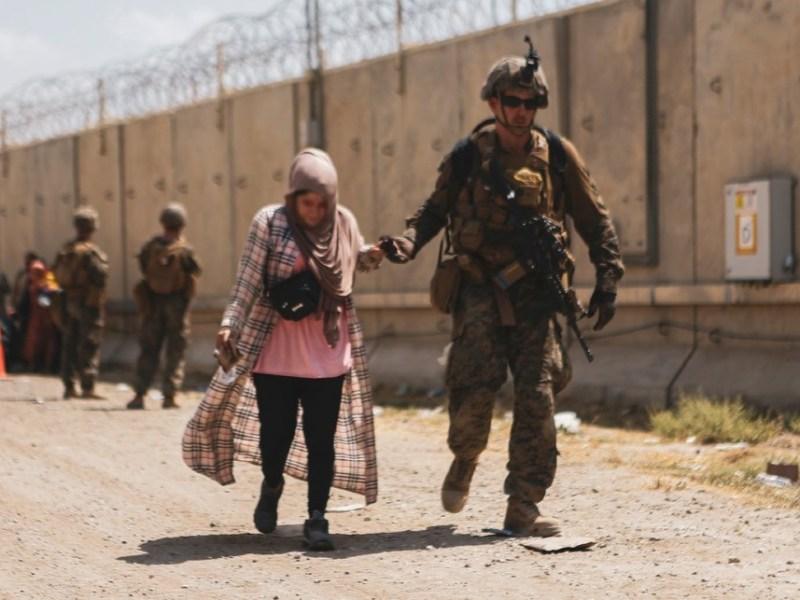 Marine helps Afghan woman