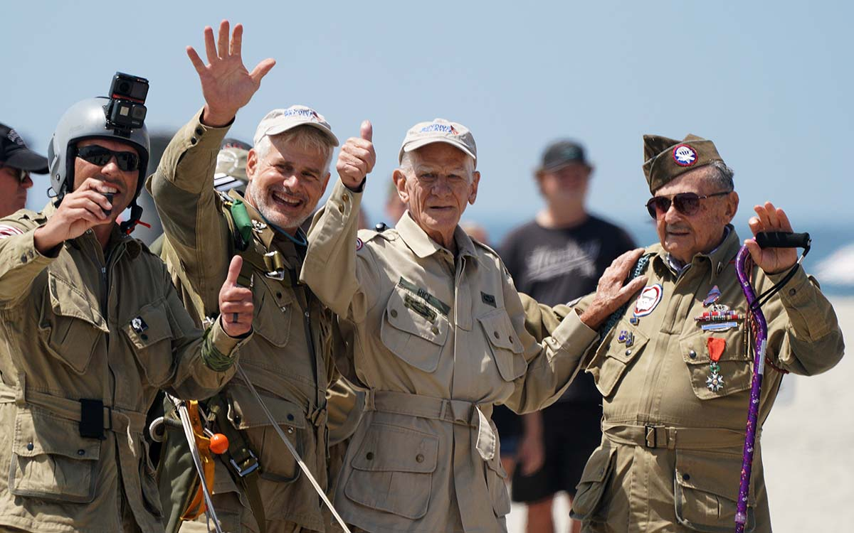 Art Shaffer (second from left) Tom Rice (second from the right) and WWII paratrooper Dan McBride (right)who also jumped on D-Day. Photo by Chris Stone