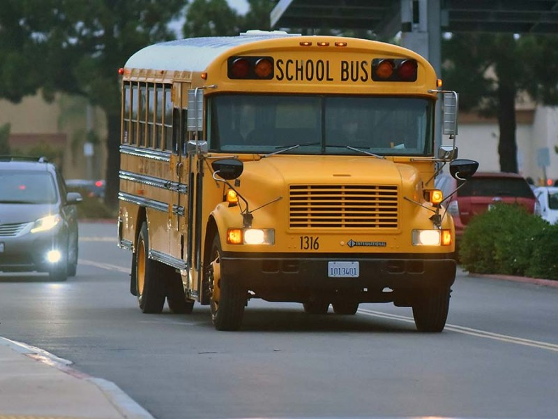 A school bus dropped students off at Mira Mesa High School. Photo by Chris Stone