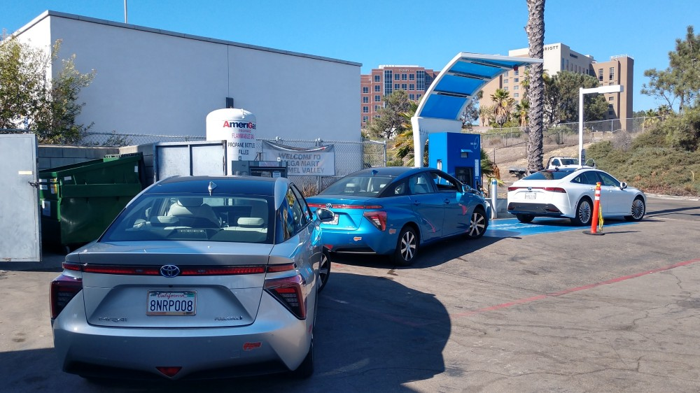 Fuel cell vehicles wait to be refueled