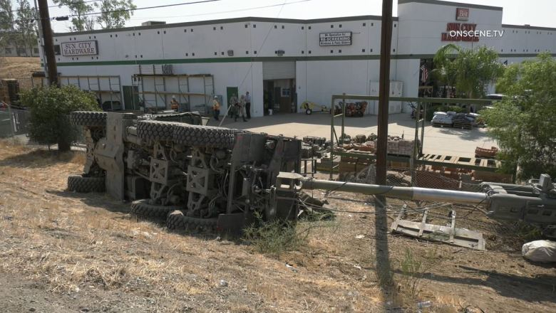 Overturned truck and howitzer