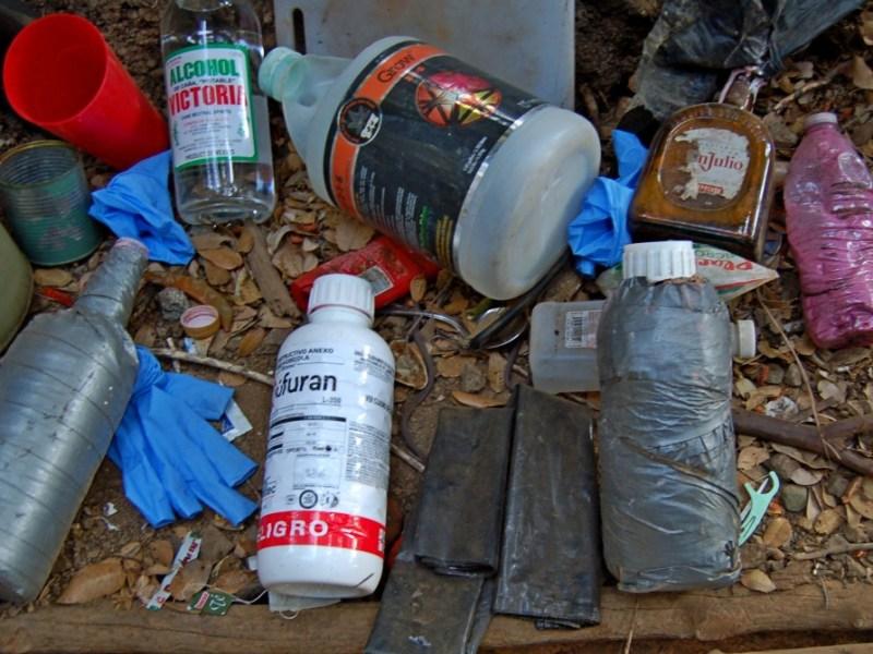 Pesticide bottle at pot grow