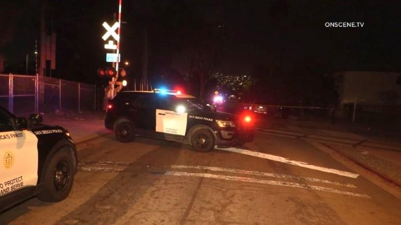 Police vehicles at scene of stabbing