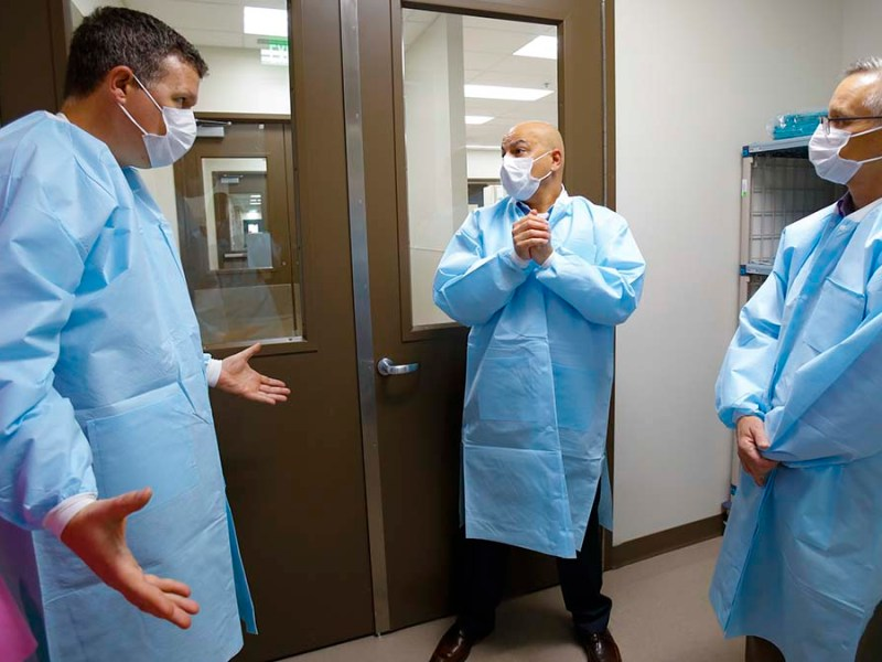 Paul Sisson (left) spoke with Sharp physicians in April, 2020, early in the pandemic.