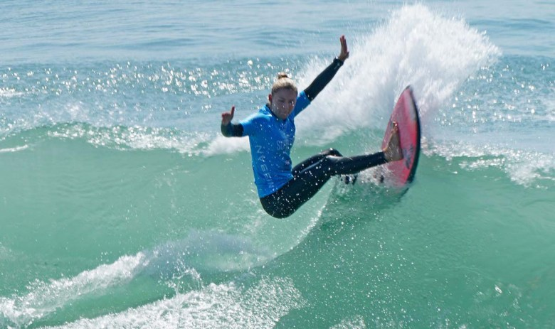 Chelsea Tuach scores points in the Super Girl Surf Pro. Photo by Chris Stone