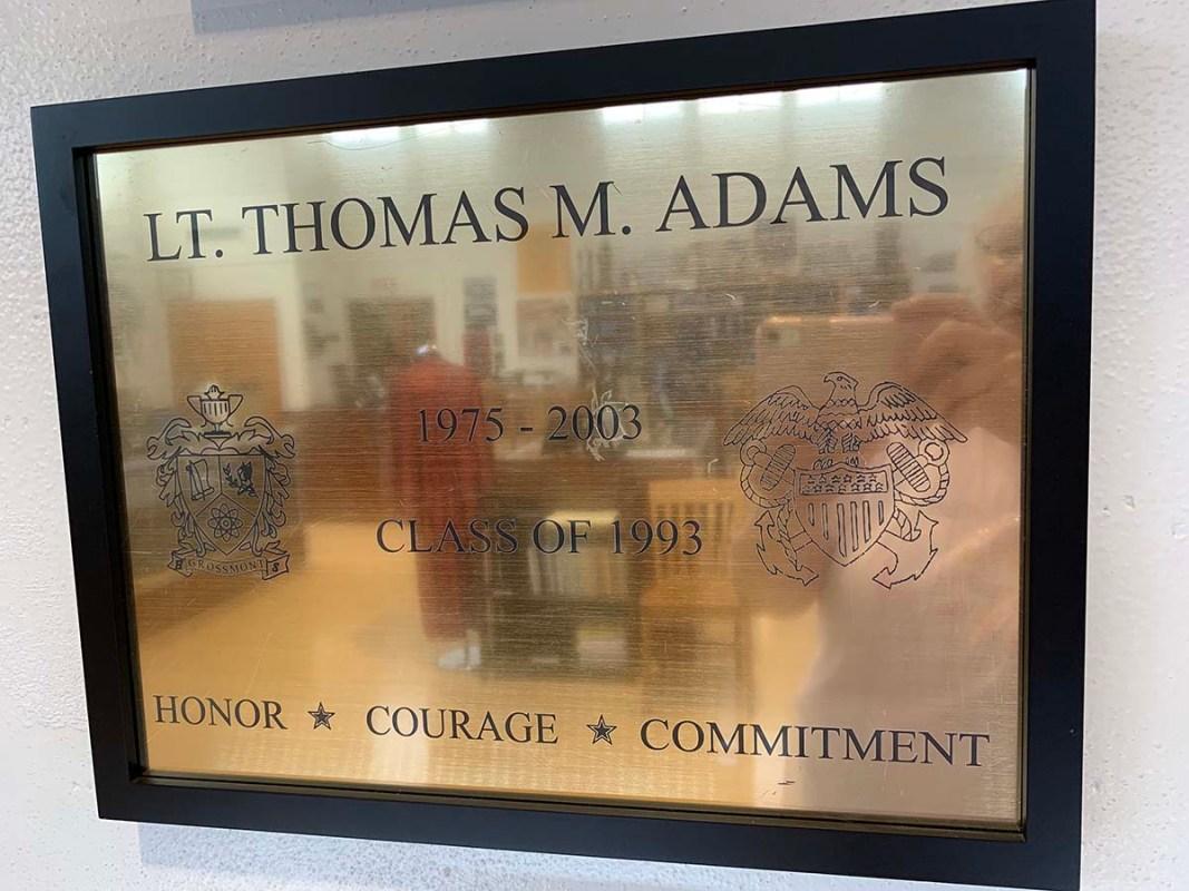 A plaque at the Grossmont High School Museum honors 1993 alumnus Thomas Adams