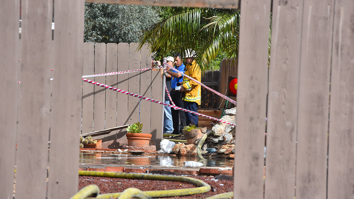 FAA officials begin examining the crash site. Photo by Chris Stone