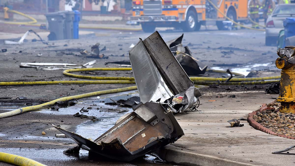 Debris from the crash of a plane into a UPS truck is strewn on the streets. Photo by Chris Stone