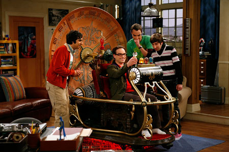 Leonard in the Time Machine as Raj, Sheldon, and Howard watch