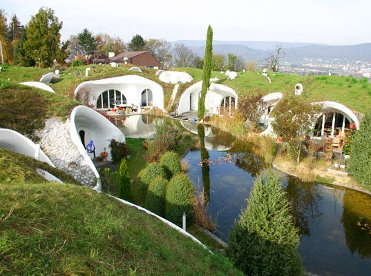 http://ldarchdesign.com/2012/01/23/less-water-grass-grows-right-up-over-the-house/