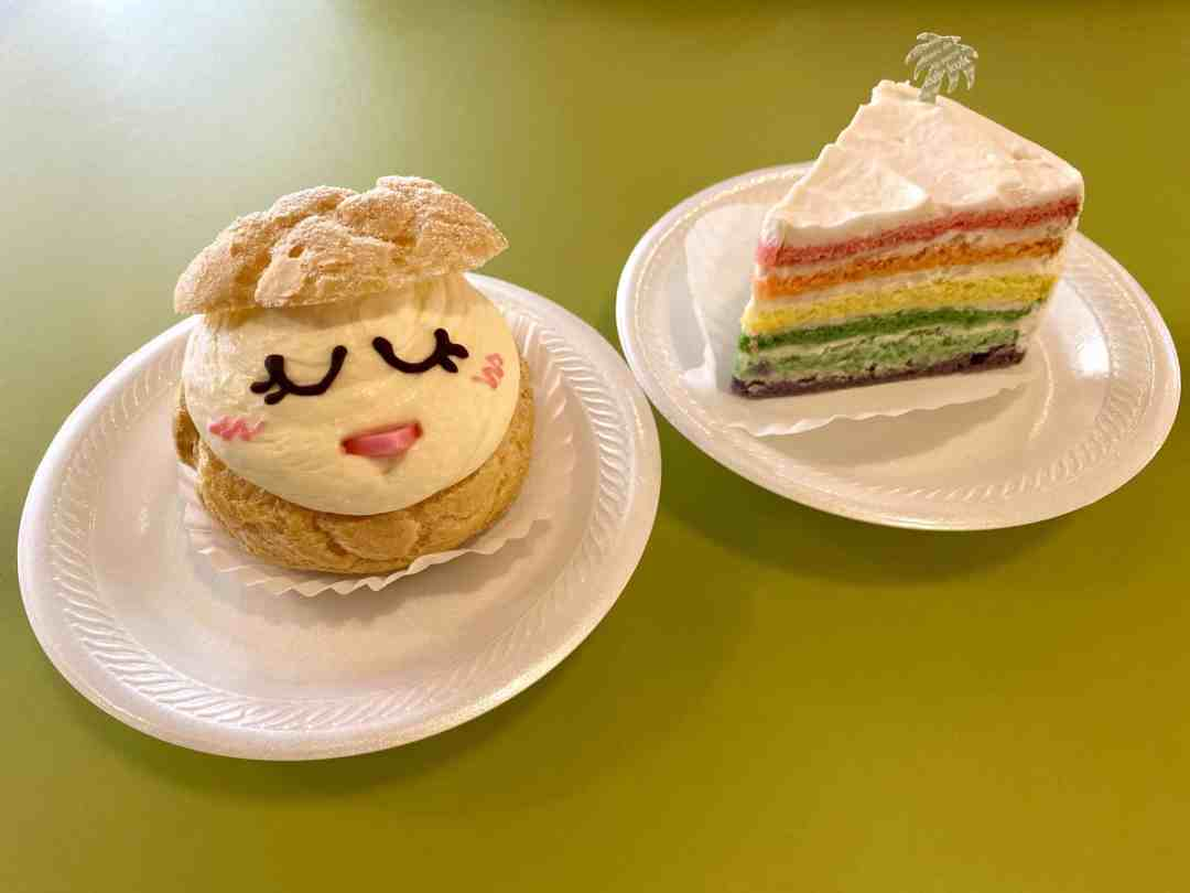 Rainbow cake and party decorated to look like a chick