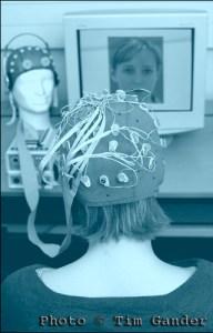 female with brain activity recording cap on.