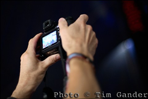 man's hands holding camera