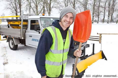 Snowplough operative with truck and shovel
