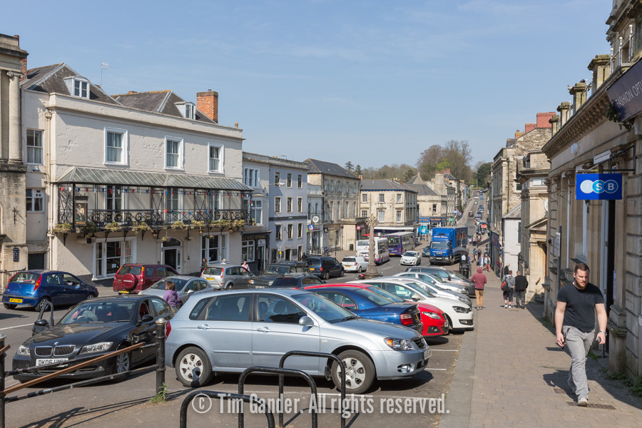 Looking towards High Street from Market Cross car park in Frome Town Centre, Somerset.