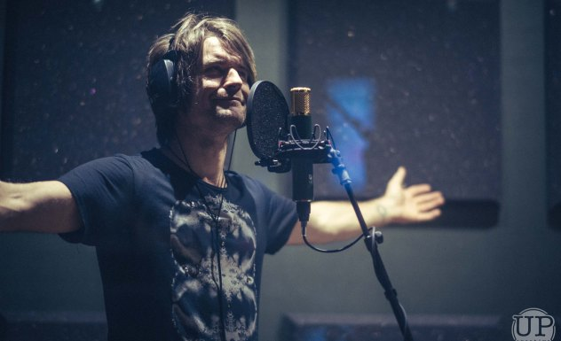 Tim Hulsman Arms Wide in Vocal Booth