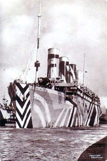 RMS Olympic in dazzle paint during the First World War, where the strength and manoeverability she shared with her sister, Titanic, allowed her to ram and sink an enemy submarine