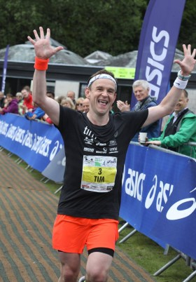 Tim crossing the final finish line