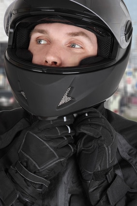 young motorcyclist man wearing helmet