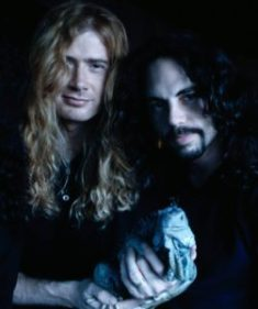 Dave Mustaine, Nick Menza, and some smug lizard.