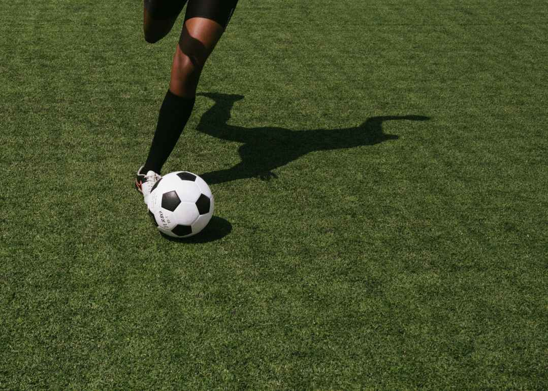anonymous soccer player on field during match