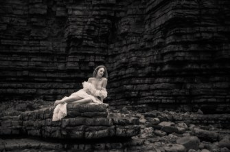 Lady On The Rocks