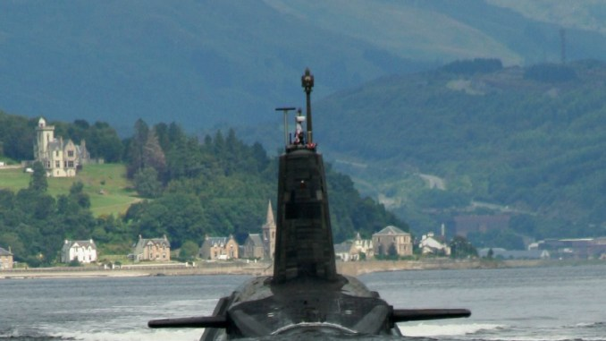 A Trident missile armed Vanguard class ballistic missile submarine leaving its base in the Firth of Clyde. Photo: bodgerbrooks, CC BY-SA 2.0, $3