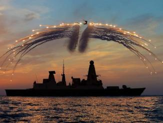 A flare firing over a Type 45 destroyer in 2013. The British ships have been beset by engine problems. DAVE JENKINS/CROWN COPYRIGHT/PA