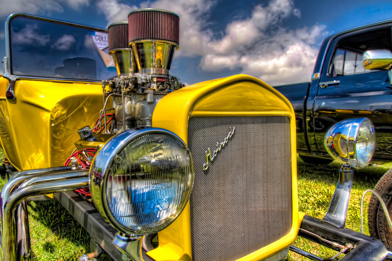 This yellow T-bucket is a great representation of a typical hotrod you might see at a car show. A small, lightweight body, with an oversized engine that just makes your mouth water. It's made for cruising as much as speed. It's hard to get all those admiring looks, if you're flying down the road too fast for people to see. Photo by Tim Stanley Photography.