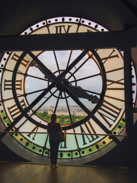 A view looking out from the Museum de Orsay in Paris through one of it's two large clocks on the roof. Photo by Tim Stanley Photography.