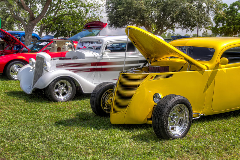 It's odd how two things can be so similar, yet so different. These two classic hotrods are alike in that they have been customized with body modifications, paint, engine, suspension and more. Yet their tastes vary in color, fenders, even down to the mirrors. Both reflect a different taste in style, yet both show great style in the quality and outcome of their restoration. Tim Stanley Photography.