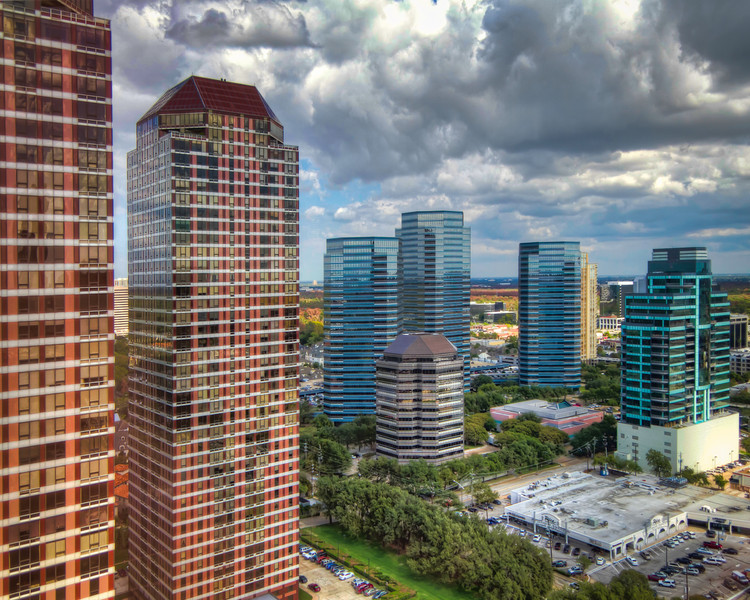 This is a look at the Four Leaf Towers on the left and the Four Oaks Place office buildings in the distance in west Houston. Photo by Tim Stanley Photography.
