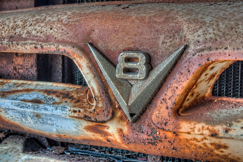 This is the front grill of an old Chevy truck (I think) permanently parked at a restaurant on the beach. It may never see road action again, but it still gets noticed a lot. Photo by Tim Stanley Photography.