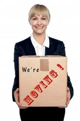Business woman with moving box