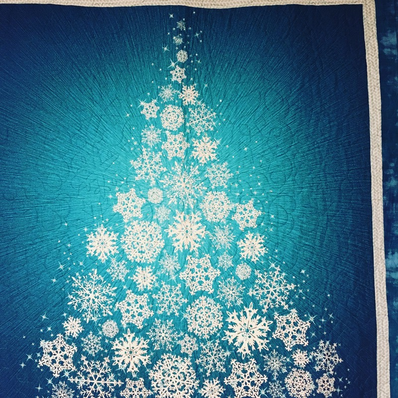 A christmas tree made out of snowflakes.