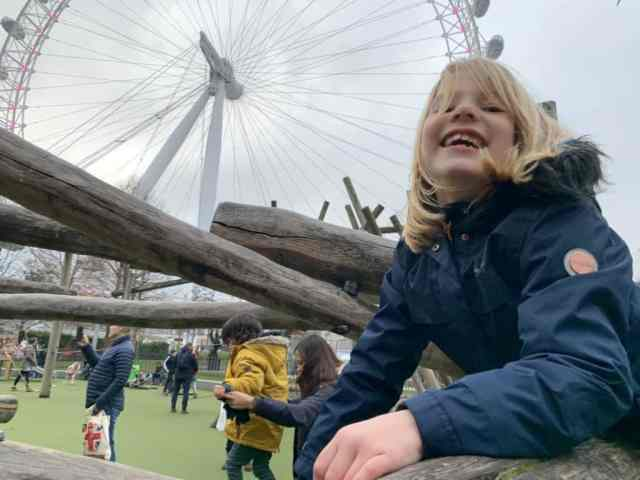 Tot on Jubilee park playground with The London Eye in the background