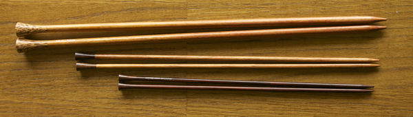 Straight wooden knitting needles.