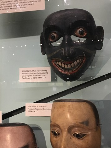 I spy a similar mask in the Pitt Rivers Museum