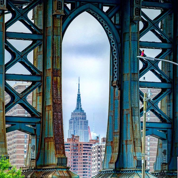 View of the Empire State Building through the rusty Manhattan Bridge footing, DUMBO, Brooklyn
