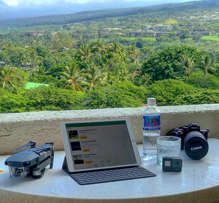 This is how an engineer packs for a family vacation! Photography equipment for land water and air! The most useful tool on this table is the @tripadvisor mobile app. Wouldn't leave home without it to be a part of the team that built the app, Sheraton Kona