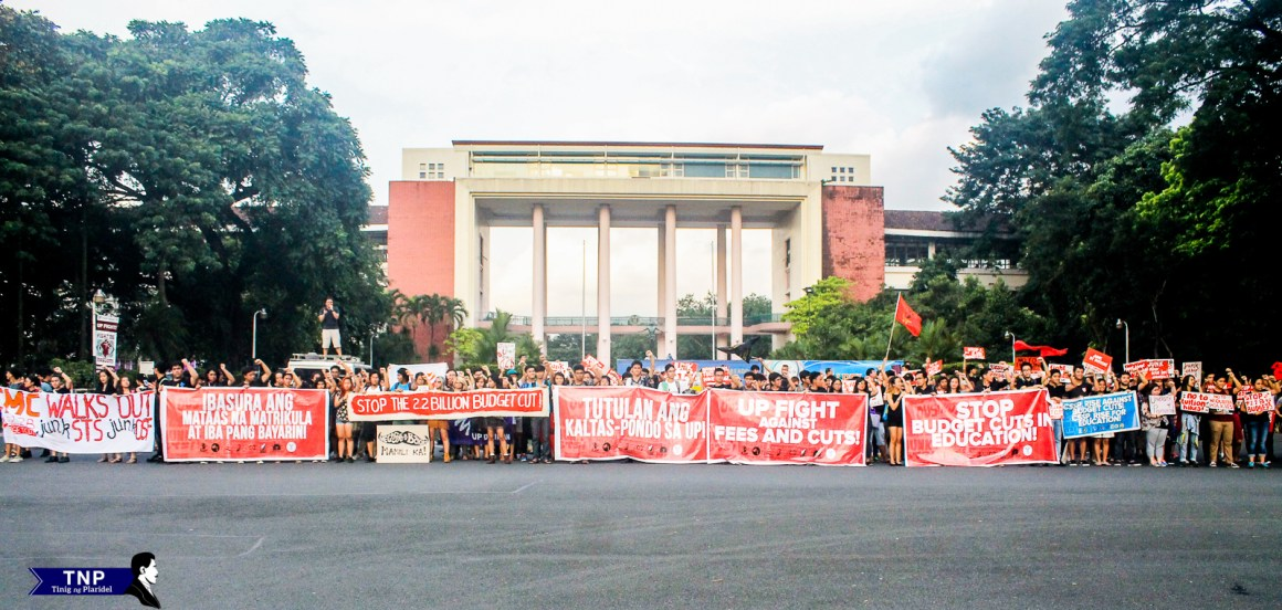 Students gather in front of Quezon Hall to protest against the impending P2.2-billion cut in UP's budget for 2016.