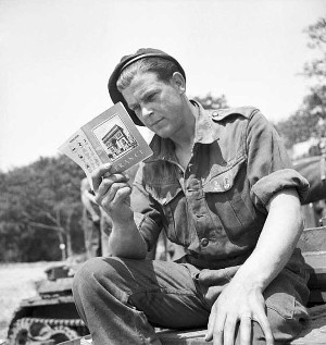 A soldier reads a pamphlet