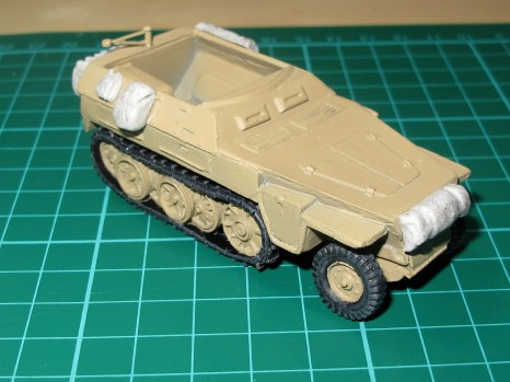 Basecoat in Dunkelgelb spray, with tracks and tires painted and drybrushed.