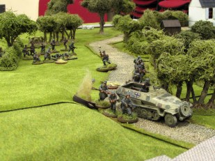 More Germans move up to the road, lining the hedges and using the Hanomag as cover