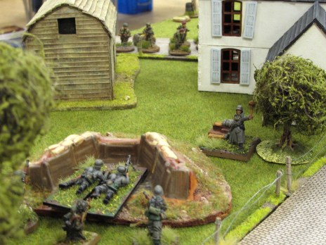 A German MG team deploys right in front of the Paras advancing in the open