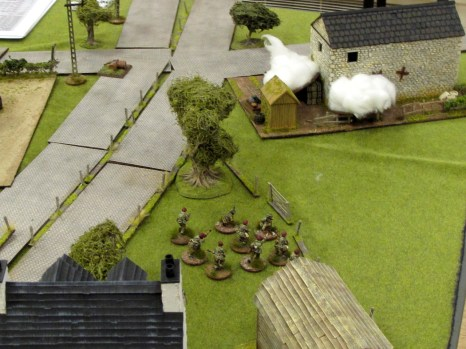 The last German defenders are holed up in the barn, with smoke blocking their view.