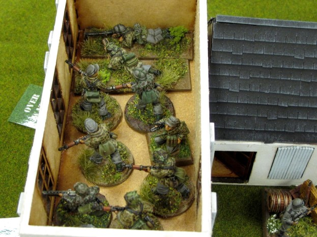 Germans deploy into the farmhouse and engage the Bren guns across the road