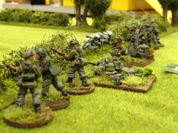 Germans take up a firing line along the hedgerow