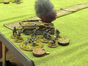 The second German half track is knocked out and the passengers debus